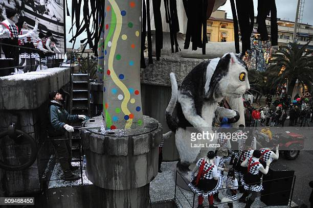 A close up of a giant papermache float with a a driver moves through the streets of Viareggio during the traditional Carnival of Viareggio parade on...