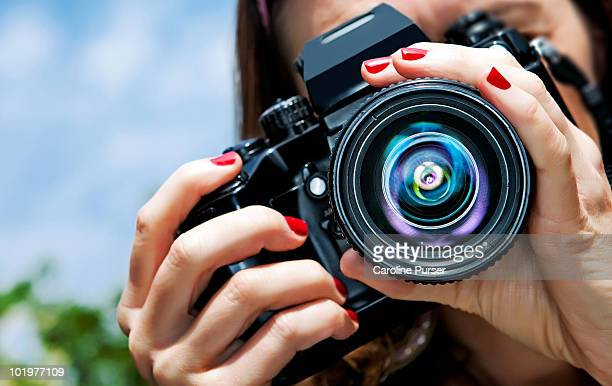 close up of a girl taking a picture (to camera) - photographer stock pictures, royalty-free photos & images