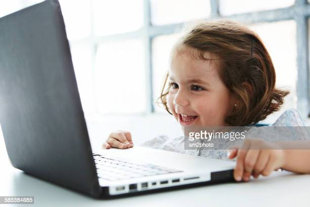 Close up of a girl using laptop