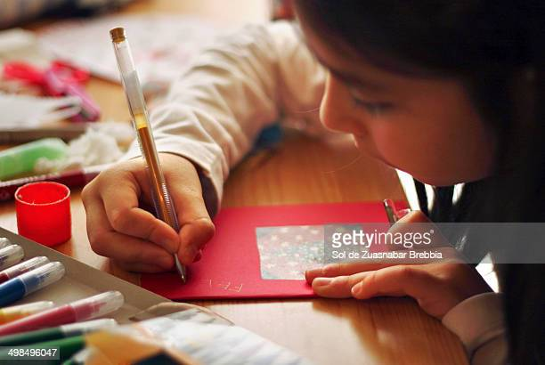 close up of a girl's hand writing a postcard - correspondence stock pictures, royalty-free photos & images