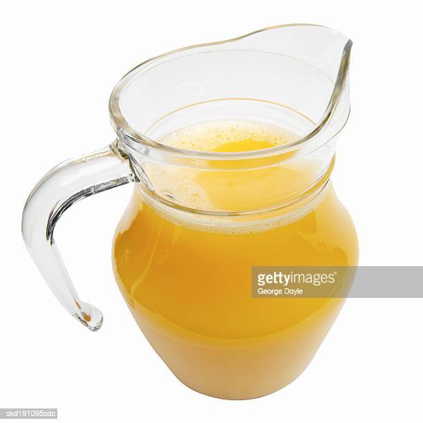 close up of a glass jug of orange juice - pitcher stock pictures, royalty-free photos & images