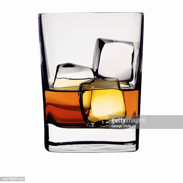 Close up of a glass of whiskey and ice
