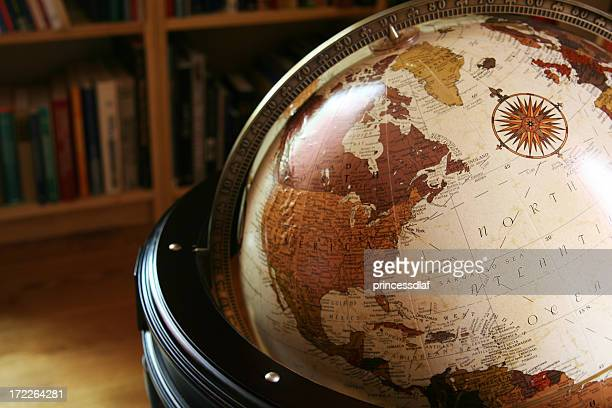 close up of a globe in a library - vintage world map stock photos and pictures