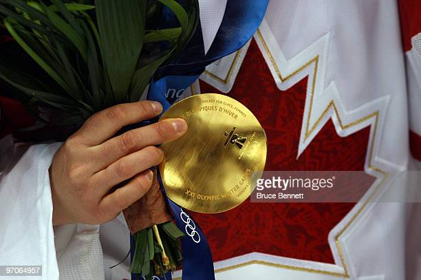 A close up of a gold medal received by a member of Team Canada following their team's 20 victory during the ice hockey women's gold medal game...