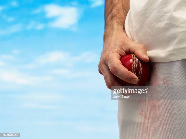 close up of a hand holding a cricket ball - cricket ball stock pictures, royalty-free photos & images