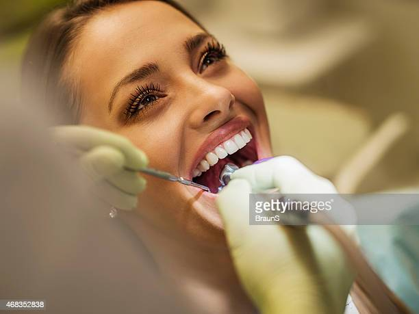Close up of a happy woman visiting dentist.
