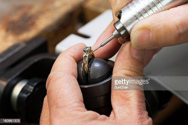 Close up of a jeweler's hands doing a repair