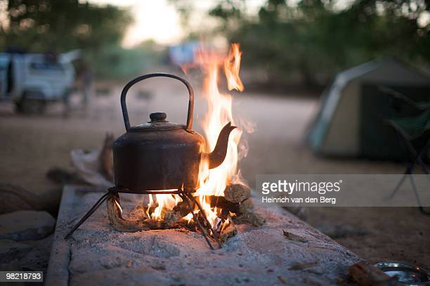 Close up of a kettle standing on a tripod over an open fire, Van Zyl��ôs Pass area, Kaokoland, Namib