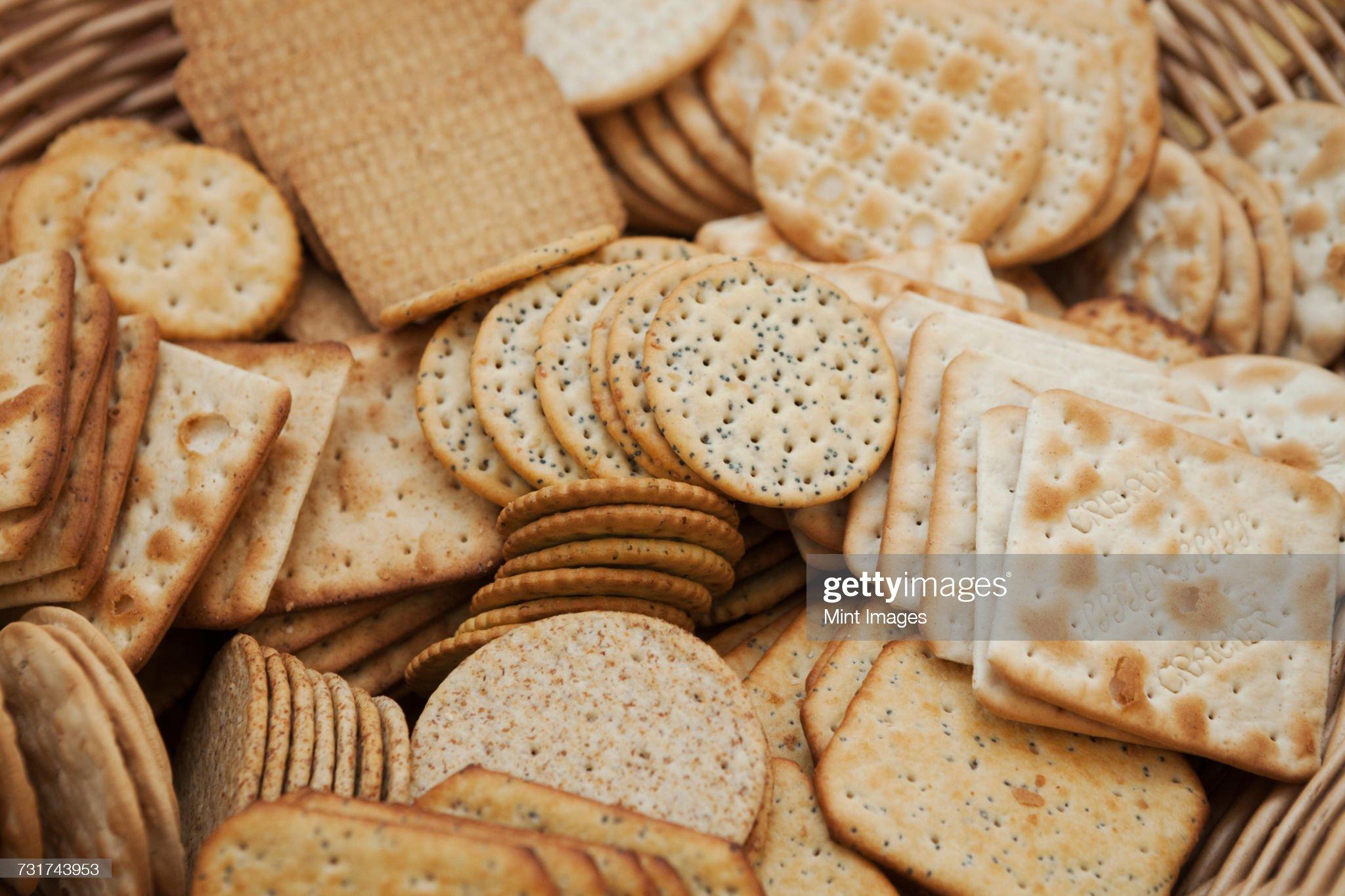 Close up of a large selection of cream crackers. : Bildbanksbilder