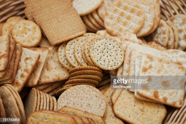 Close up of a large selection of cream crackers.