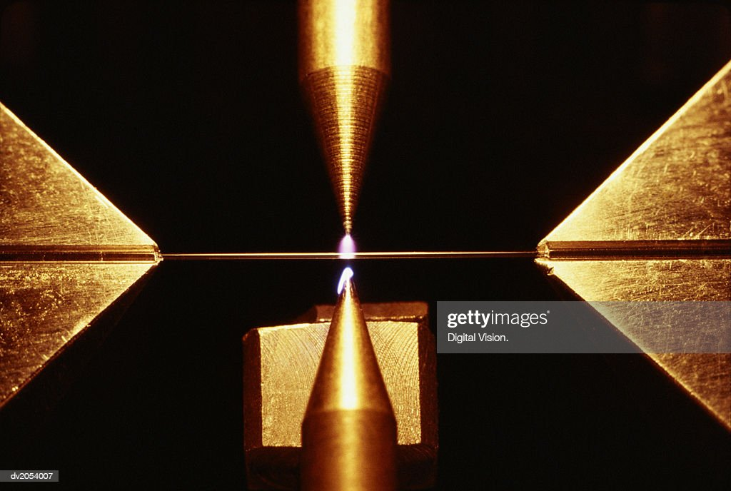 Close Up of a Laser Tool Cutting a Metal Plate : Stock Photo