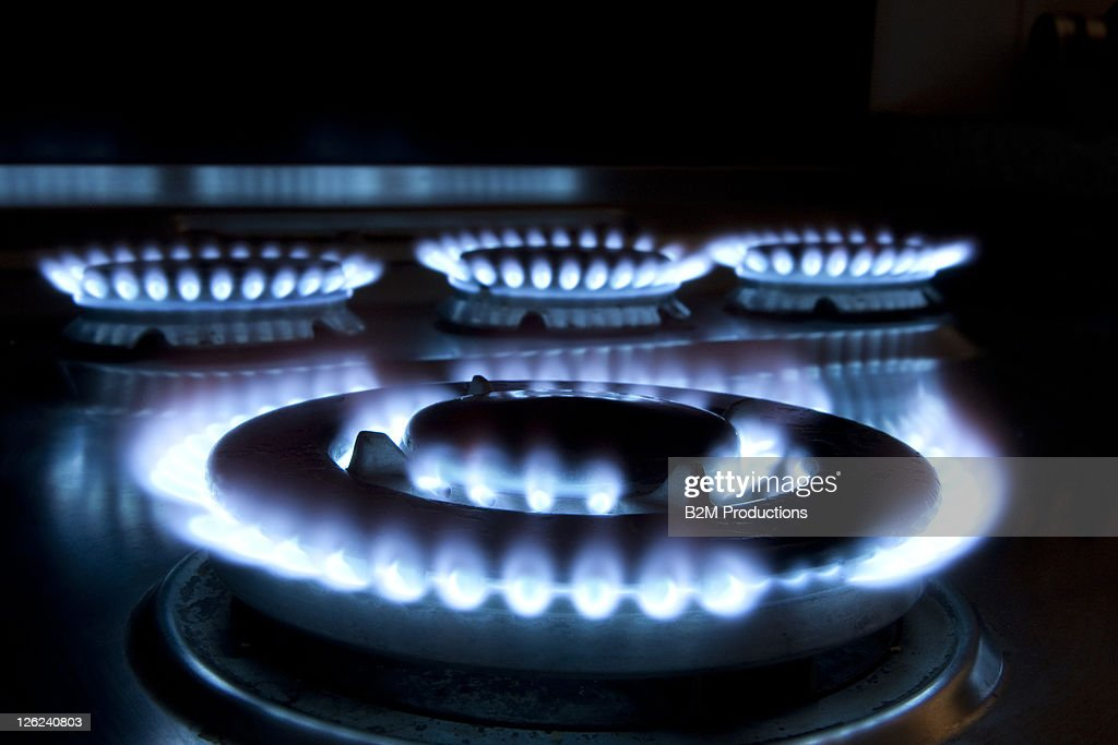 Close up of a Lit Hob : Stock Photo