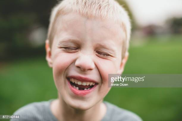 Close up of a little boy who is laughing