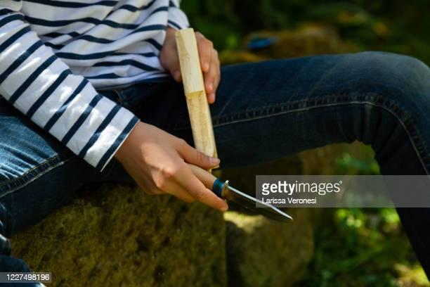 close up of a little girl carving wood - larissa veronesi stock-fotos und bilder