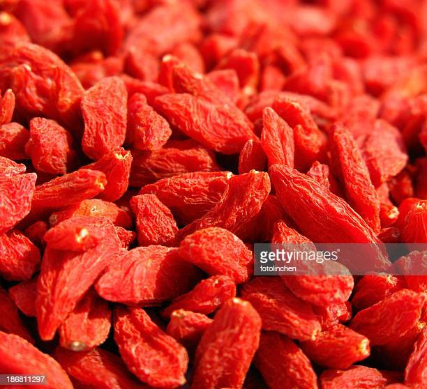A close up of a lot of goji berries