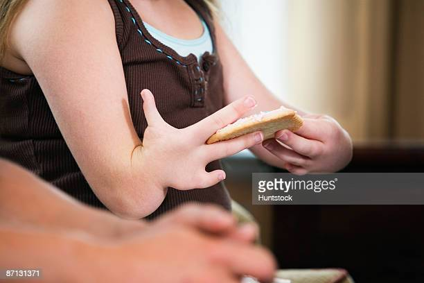 close up of a malformed hand holding a cookie - deformed hand stock pictures, royalty-free photos & images