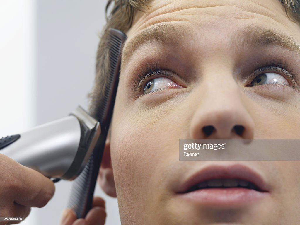 Close up of a Man Having His Hair Cut : Stock Photo