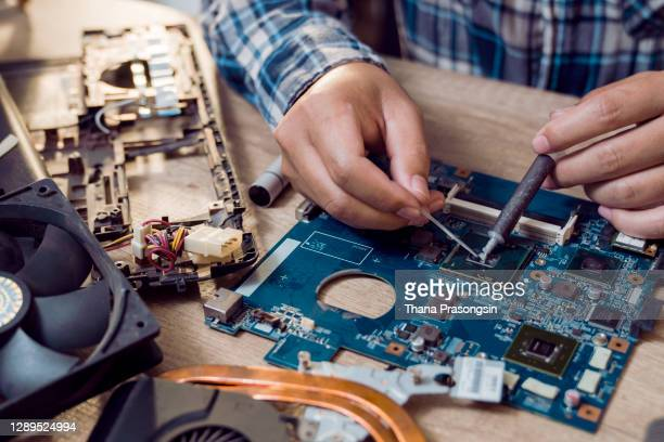 close up of a man soldering computer chip - repairing stock pictures, royalty-free photos & images