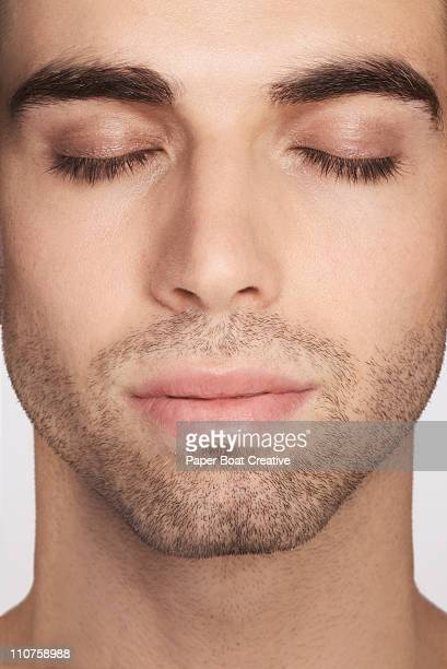 close up of a man with his eyes closed