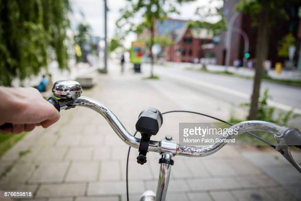 close up of a man's hand holding a bicycle handlebar in hafen city, germany in spring - may stock pictures, royalty-free photos & images