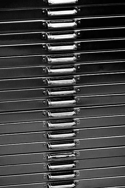 Close up of a metal filing cabinet.