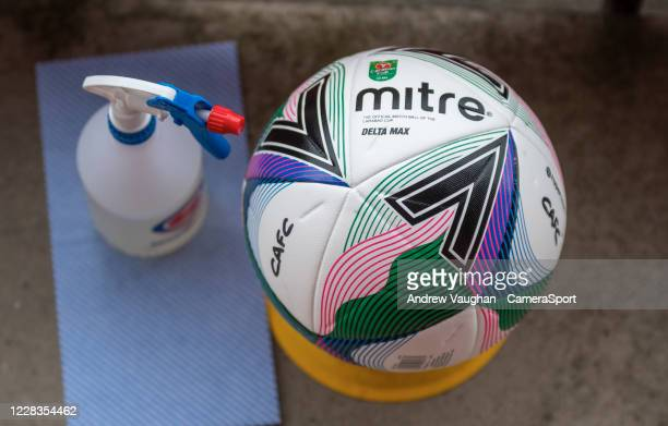 Close up of a Mitre Delta Max official EFL Carabao Cup football next to disinfectant spray and wipe as part of the Covid-19 safety precautions prior...