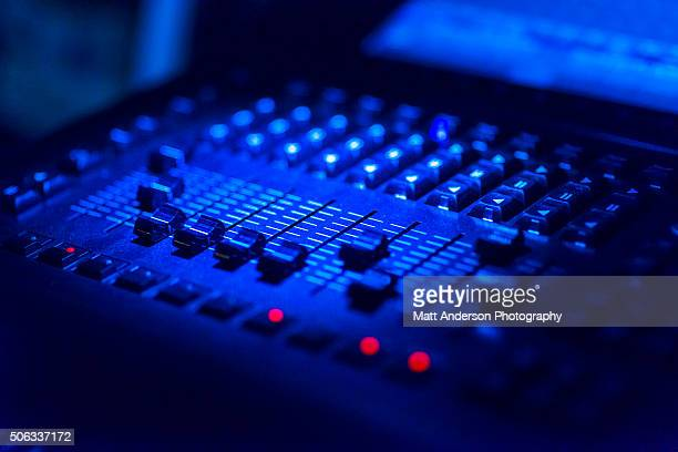 Close up of a mixing board in moody light
