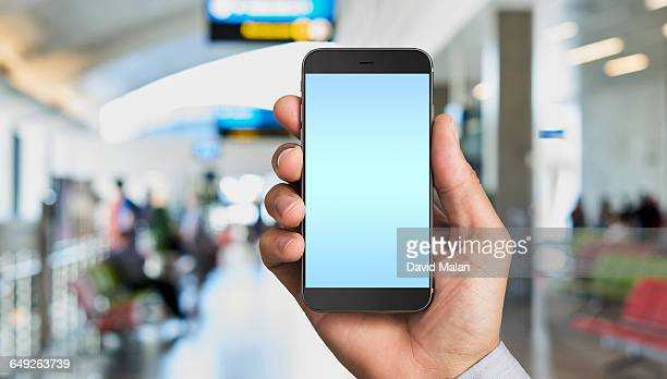 Close up of a mobile phone in an airport