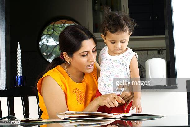 Close up of a mother teaching her child to read