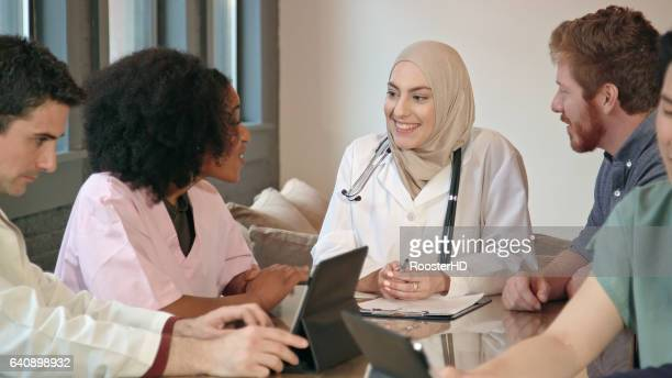 Close Up of a Muslim Female Doctor Leading Multi-Ethnic Medical Team