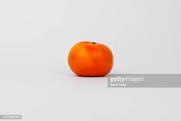 close up of a nadorcott mandarin / tangerine in a photo studio. - tangerine stock pictures, royalty-free photos & images