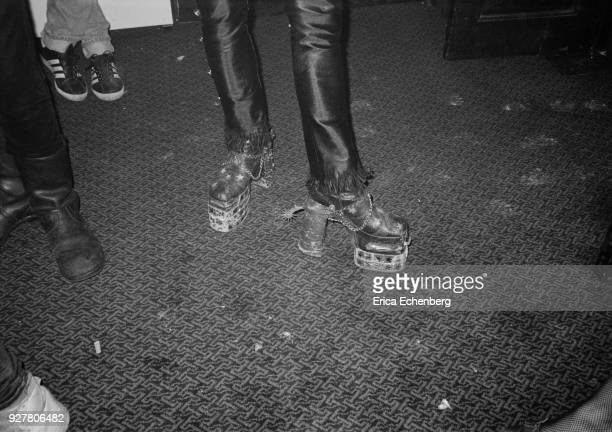 Close up of a pair of glam metal high heeled platform boots with spurs, London, 1984.