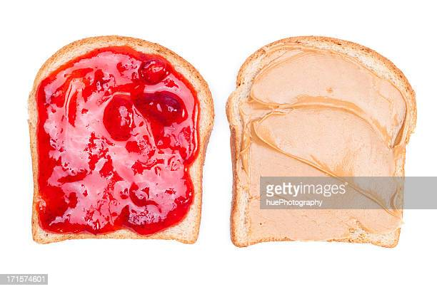 close up of a peanut butter & jelly sandwich on white bread - peanut butter and jelly sandwich stock pictures, royalty-free photos & images