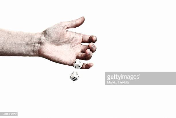 Close up of a person's hand throwing dices