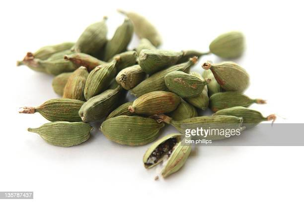 Close up of a pile of cardamom pods