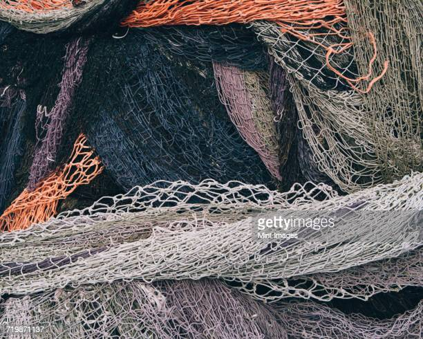Close up of a pile of tangled up commercial fishing nets.