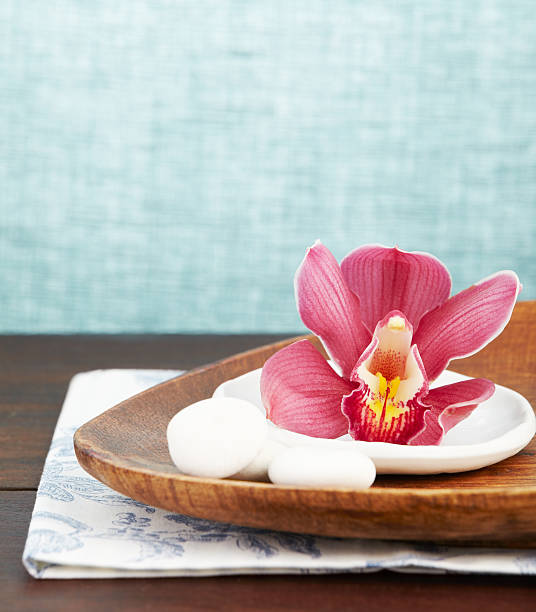 Close Up Of A Pink Orchid On Wooden Tray Wall Art