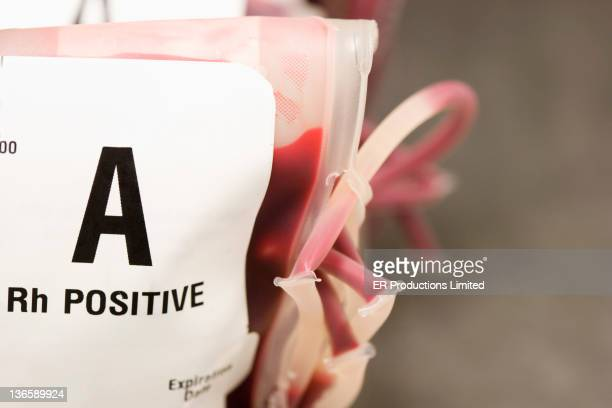 close up of a positive blood in bag - blood group stock pictures, royalty-free photos & images