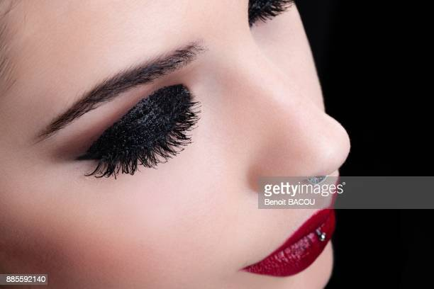 Close up of a pretty girl with black makeup