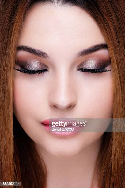 Close up of a pretty girl with silver makeup