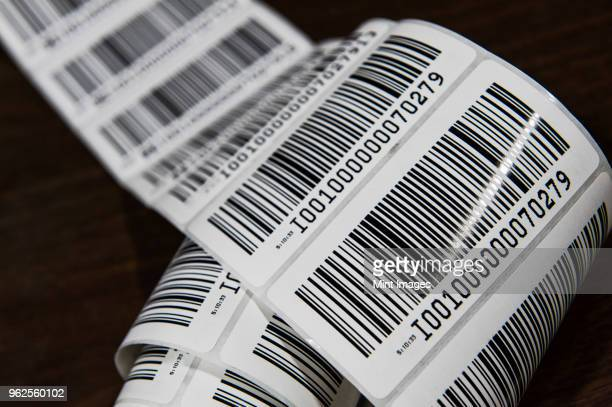 close up of a printed barcode label on a roll, packing and distributing goods in a distribution warehouse. - bar code stock pictures, royalty-free photos & images