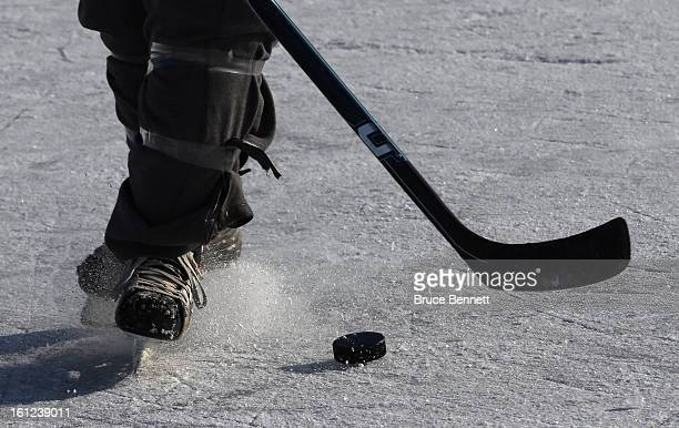 A close up of a puck in motion during the 2013 USA Hockey Pond Hockey National Championships on February 9 2013 in Eagle River Wisconsin The threeday...
