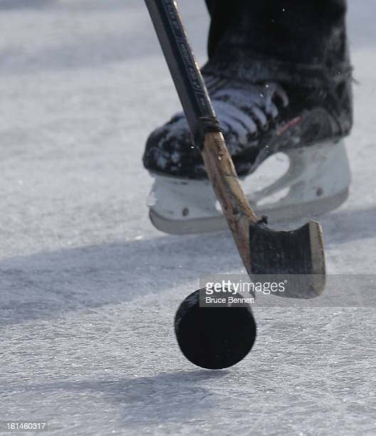 Close up of a puck in motion during the 2013 USA Hockey Pond Hockey National Championships on February 9, 2013 in Eagle River, Wisconsin. The...