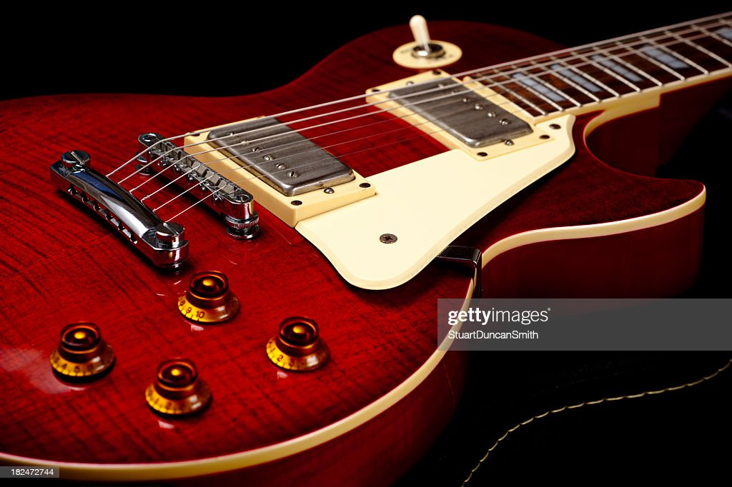 Close up of a red electric guitar : Stock Photo