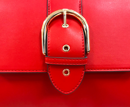 Close up of a red purse detail showing belt buckle design on flap - gettyimageskorea