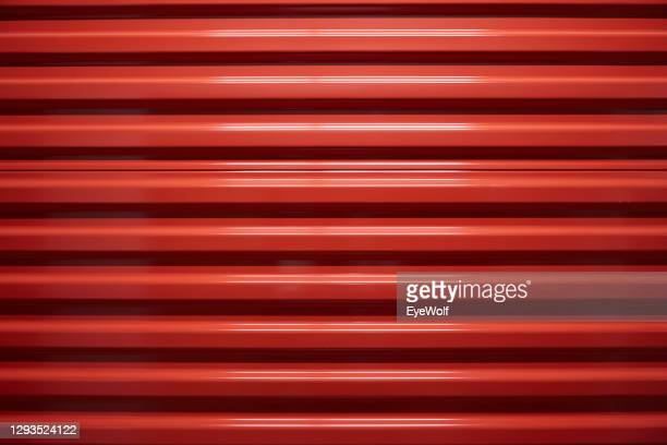 close up of a red textured door. - metallic stock pictures, royalty-free photos & images