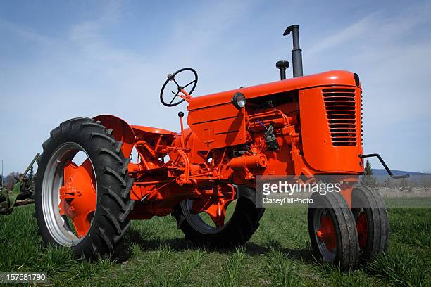 close up of a red tractor on grass - tractor stock pictures, royalty-free photos & images