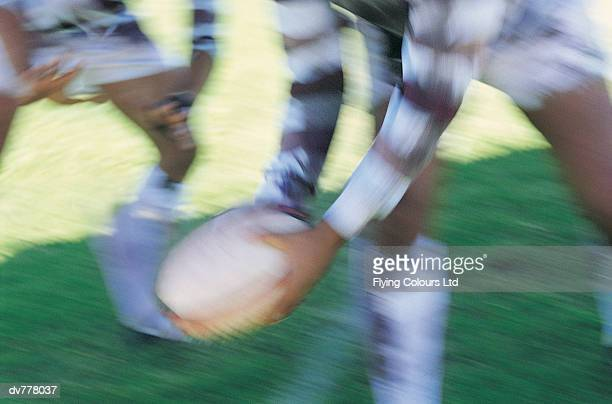Close up of a Rugby Union Player Passing The Ball