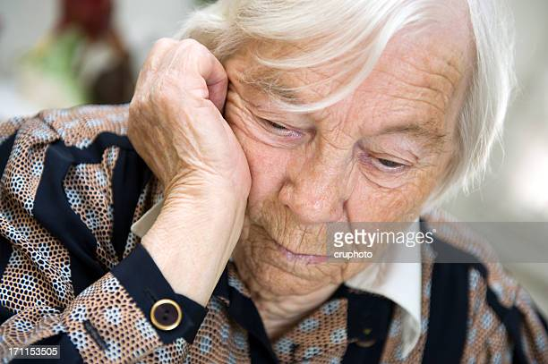 A close up of a sad elderly woman