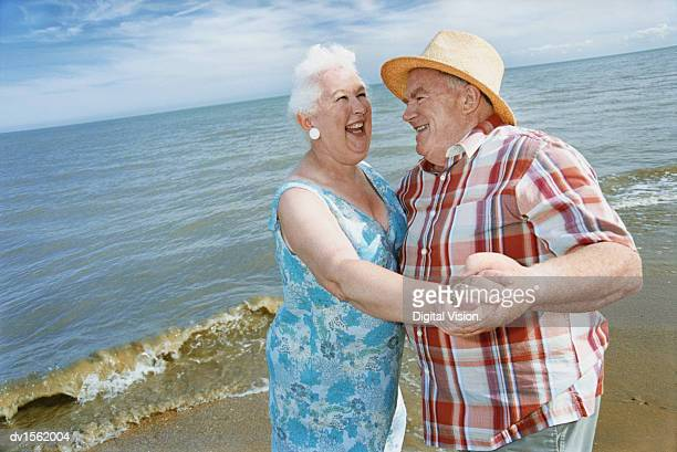 Close up of a Senior Couple Dancing at Water's Edge